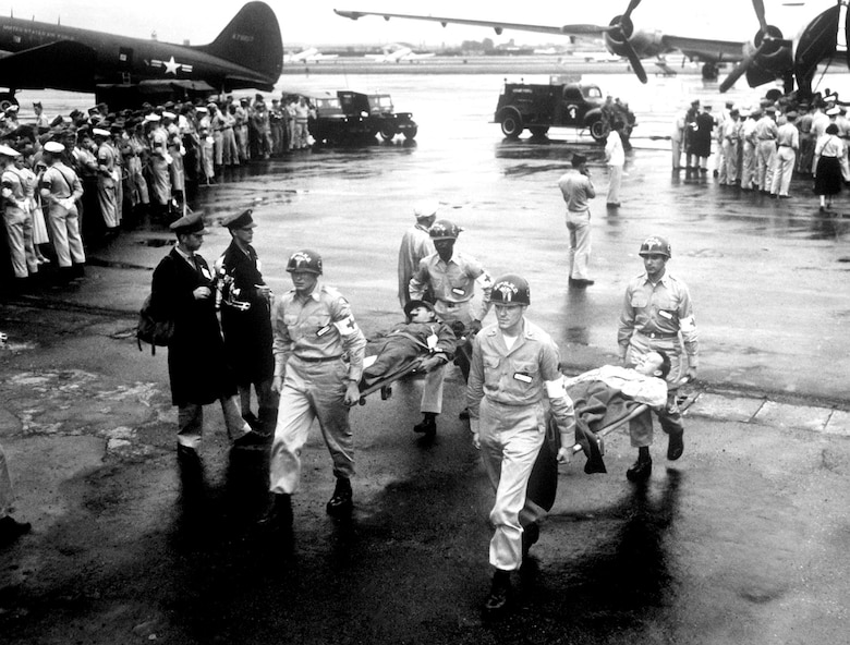 Many POWs required immediate medical care upon release. These exchanged prisoners are arriving at Tachikawa Air Base, Japan, in August 1953. (U.S. Air Force photo)