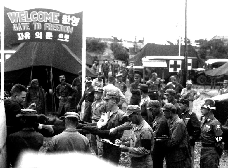 POW release to UN authorities was the first step in repatriation. Here, communists turn over UN troops at the POW receiving center at Panmunjon, on the border of North and South Korea. (U.S. Air Force photo)