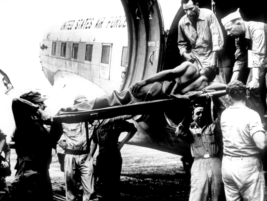 A U.S. casualty of the Korean War arrives in Japan aboard a U.S. Air Force C-47, July 1950. The U.S. Air Force Military Air Transport System took over moving patients. These flights were staffed by trained Air Force AE crews to safely transport casualties. (U.S. Air Force photo)