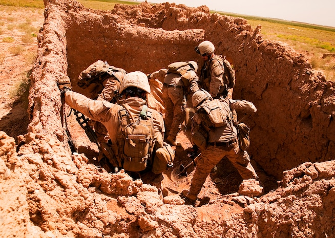 Marines from Company L, 3rd Battalion, 3rd Marine Regiment, uncover an improvised explosive device cache in an abandoned compound east of their newly established observation post in Southern Shorsurak, Helmand province, Afghanistan, during Operation New Dawn, June 20, 2010. The Marines found two directional fragmentation improvised explosive devices weighing 35 pounds each, 15 feet of detonation cord and 15 pounds of ammonium nitrate and aluminum powder. Operation New Dawn is a joint operation between Marine Corps units and the Afghanistan National Army to disrupt enemy forces, which have been using the sparsely populated region between Marjah and Nawa as a safe haven.
