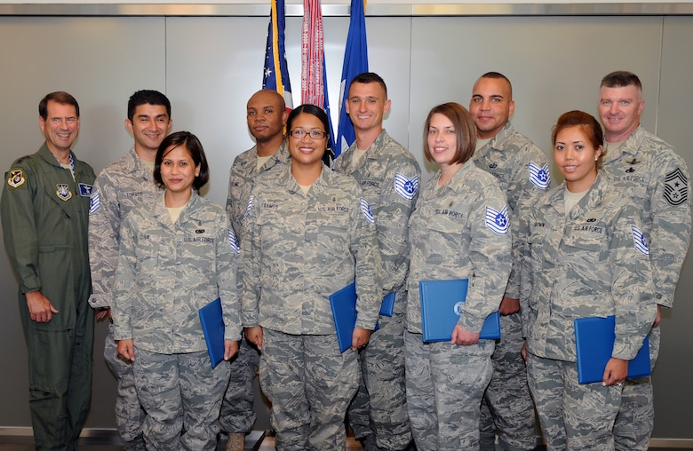 Los Angeles AFB's newest tech sergeant selectees pose with SMC Commander, Lt. Gen. Tom Sheridan. The selectee list was announced June 17. Pictured from left to right are:   Lt. Gen. Sheridan, staff sergeants Francisco Torres, Rhea Lora, Tony Young, Allita Ramos, Salvator Demarti, Danielle McEachern, Columbus Campbell and Karla Brown, and Chief Master Sgt. Mark Repp. (Photo by Jim Gordon)