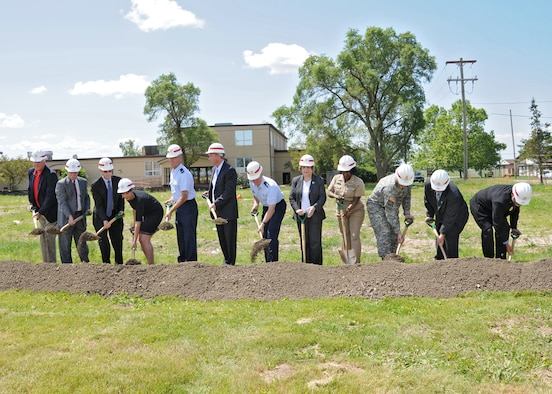 Western New York Servicemembers and Public Figures break the ground at the CAC groundbreaking ceremony, June 21, 2010, Niagara Falls Air Reserve Station, Niagara Falls, NY.  At the conclusion of the groundbreaking ceremony refreshments provided by NIMAC were prepared and served by the 914th Services Squadron. (U.S. Air Force photo by Staff Sgt. Joseph McKee