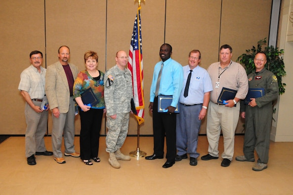 June 22, 2010, Federal employee award recipients from left to right, Dan Pihlaja, U.S. Postal Service (Safety-Security Award), Gary Keller, IRS (Law Enforcement Award), Laurie Whitehead, VA Medical Center (Professional-Scientific-Technical Award), Capt. Lucas Morales, Fargo Military Entrance Processing Station (Team Award), Constant L. Maninga, Fargo Military Entrance Processing Station (Administrative Operational Support Award), Rod Brasel, U.S. Post Office (Managerial Supervisor Award), Jim Van Hoecke, U.S. Post Office (Trade-Crafts Award), Master Sgt. Dave Somdahl, N.D. Air National Guard (standing in for Staff Sgt. Jeffrey Jacobson, Heroism - Valor Award and Civil Servant of the Year winner) at the Federal Executive Association Awards Luncheon, Holiday Inn Fargo, N.D.