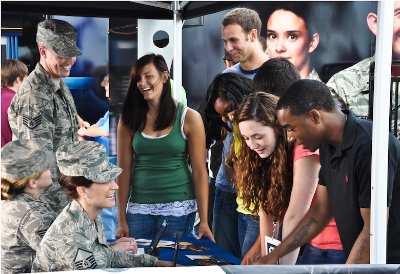 Air National Guard recruiters interact with Airmen and actors during the filming of a sizzle reel at the 128th Air Refueling Wing, Gen. Mitchell International Airport, Milwaukee, WI, on Monday, June 21, 2010.  The sizzle reel will be used in the Air National Guard's Rise to the Challenge tour, which begins on July 1, 2010, during the annual Summerfest event in Milwaukee.  (Air Force photo by Staff Sgt. Jeremy Wilson / released)