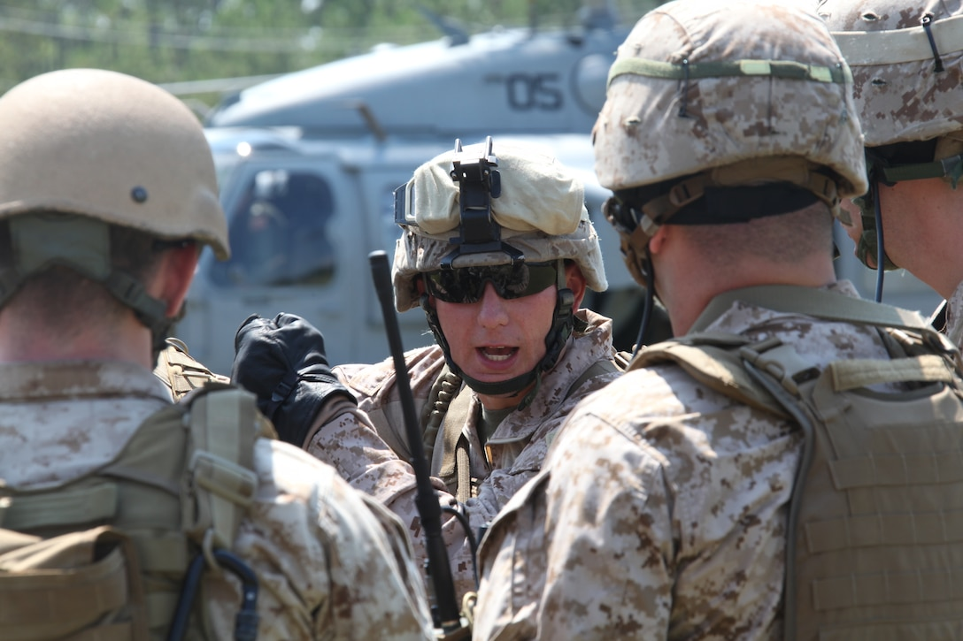 2nd Lt. Philip R. Banham, a platoon commander with Battalion Landing Team 3/8, 26th Marine Expeditionary Unit, reviews the proper procedures for fast-roping out of a helicopter prior to conducting a maritime interception exercise at a training facility in Barnwell, S.C., June 23, 2010. 26th MEU Unit's Maritime Interception Operation raid force conducted the three-day exercise in preparation for deployment this fall. The exercise hones the MEU's ability to swiftly control the operation of a hostile ship or maritime platform. (Official USMC Photo by Lance Cpl. Santiago G. Colon Jr.)::r::::n::