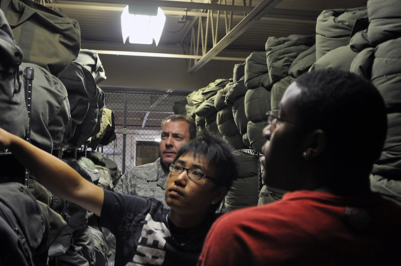 Beng Cha, 19, and Adrian Wells, 18, organize sleeping bags under the supervision of Master Sgt. William 'Bugs' Moran, the noncommissioned officer-in-charge of war readiness, in the war readiness facility at the 128th Air Refueling Wing, Gen. Mitchell International Airport, on Wednesday, June 23, 2010.  The 128 ARW hosts Milwaukee-area youth during a seven-week Aviation Careers and Education program designed to give the youths work experience for their future careers.  (U.S. Air Force photo by Senior Airman Ryan Kuntze / Released)