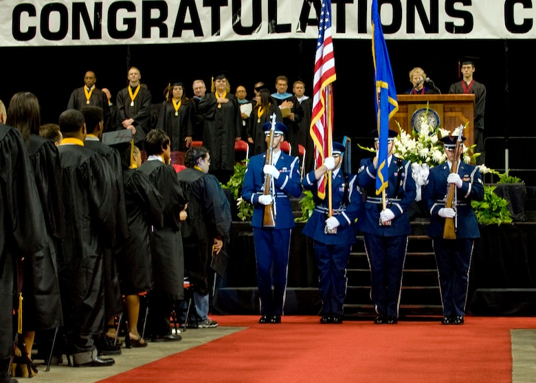 LAS VEGAS, Nev.-- Members of the Nellis Air Force Base Honor Guard present the flag during a high school graduation at the Thomas and Mack Center in Las Vegas, June 9, 2010. (U.S. Air Force Photo / Airman 1st Class Jamie Nicley)