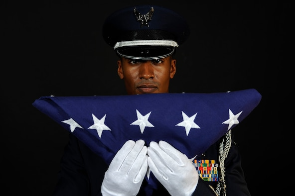 ELLSWORTH AIR FORCE BASE S.D. -- Capt. Bishane Whitmore, Ellsworth AFB Honor Guard officer in charge, stands at attention after completing the flag dressing sequence, June 24.  The Base Honor Guard's primary mission is to represent Ellsworth and the Air Force at public and official ceremonies. (U.S. Air Force photo/Staff Sgt. Marc I. Lane)