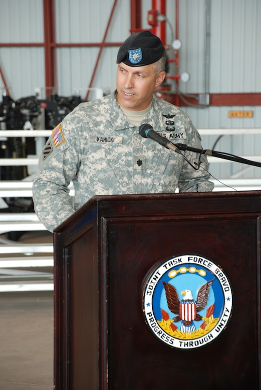 SOTO CANO AIR BASE, Republic of Honduras --  Lt. Col. James Kanicki gives his first speech as commander of the 1st Battalion, 228th Aviation Regiment during a ceremony here June 24. Colonel Kanicki, a native of Ashtabula, Ohio, most recently was commander of the Warrior Transistion Battalion in Fort Stewart, Ga. (U.S. Air Force photo/Tech. Sgt. Benjamin Rojek)