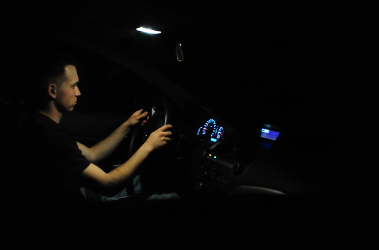 ELLSWORTH AIR FORCE BASE, S.D. -- Senior Airman David Carter, 28th Maintenance Squadron aerospace ground equipment journeyman, drives on winding back-roads at night, June 23.  Driving long distances while tired is equivalent to driving while intoxicated, especially while driving at night due to low visibility. (U.S Air Force photo/Airman 1st Class Anthony Sanchelli)