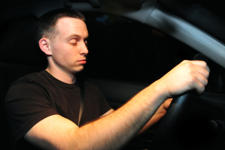 ELLSWORTH AIR FORCE BASE, S.D. -- Senior Airman David Carter, 28th Maintenance Squadron aerospace ground equipment journeyman, slowly blinks his eyes, showing fatigued driving symptoms, June 23.  Driving while fatigued has the same risks as driving while intoxicated. (U.S Air Force photo/Airman 1st Class Anthony Sanchelli)