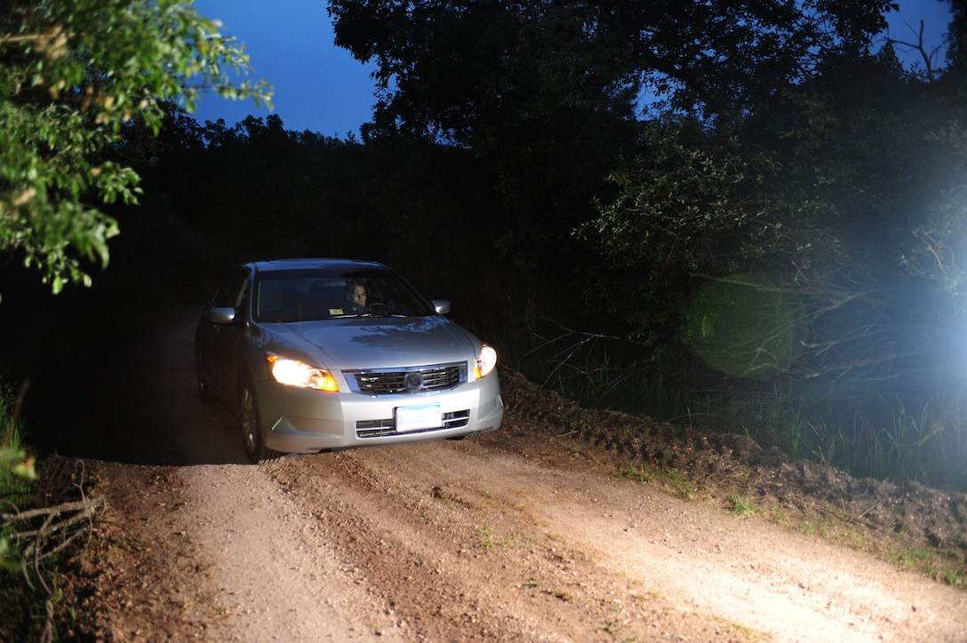 ELLSWORTH AIR FORCE BASE, S.D. -- Senior Airman David Carter, 28th Maintenance Squadron aerospace ground equipment journeyman, drives down a winding dirt road the night of June 23.  It's important if taking long trips to drive safely as well as get adequate sleep before operating a vehicle. (U.S Air Force photo/Airman 1st Class Anthony Sanchelli)