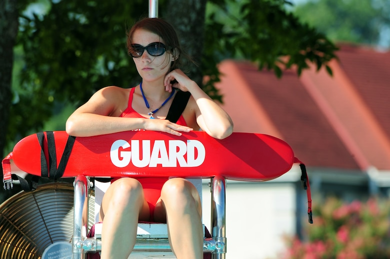BARKSDALE AIR FORCE BASE, La. -- Kasey Schluter, Barksdale lifeguard, watches over swimmers at Barksdale's North Pool. Ms. Schluter, along with her fellow lifeguard, Jacbo Navarro, saved the life of a young boy who almost drowned May 28. (U.S. Air Force photo by Senior Airman Joanna Kresge) (RELEASED)