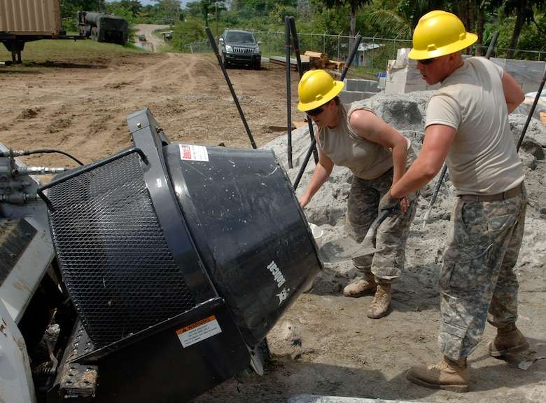 Spc. Jennifer Bartlein (left) and Pfc. Wayne Paliwoda, construction engineers with the 372nd Engineer Company, mix concrete June 26 at Santa Librada elementary school in Panama. The Army Reservists are deployed in support of New Horizons Panama 2010, a humanitarian assistance mission designed to strengthen partnerships between the United States and Panama. (U.S. Air Force photo/Tech. Sgt. Eric Petosky)