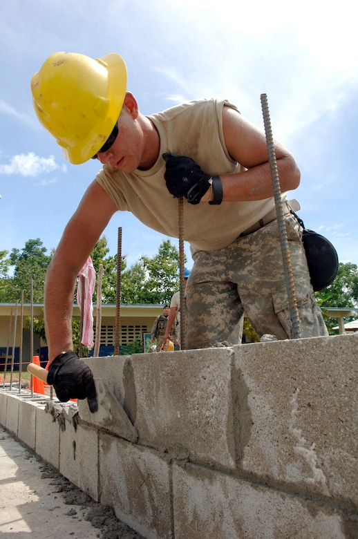 Spc. Michael Wiken, construction engineer with the 372nd Engineer Company, uses mortar on the first layer of bricks June 26 at Santa Librada elementary school in Panama. The Army Reservists are deployed in support of New Horizons Panama 2010, a humanitarian assistance mission designed to strengthen partnerships between the United States and Panama. (U.S. Air Force photo/Tech. Sgt. Eric Petosky)
