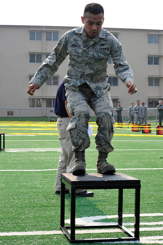 Senior Airman Alfredo Camacho, 51st Maintenance Squadron, completes one foot box jumps during a Warrior Challenge competition, put on by the Osan Fitness Center. Throughout the competition four teams were timed as they completed several physical tasks. The team with the fastest time won trophies for each of its members. (U.S. Air Force photo/ Staff Sgt. Eunique Stevens)