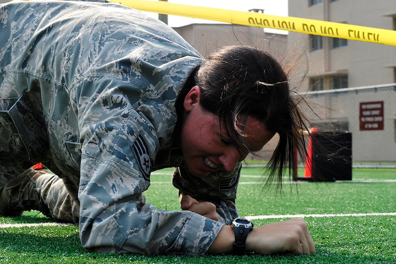 Staff Sgt. Melenie Rogers, 51st Operations Support Squadron, completes a 100 ft. low crawl during a Warrior Challenge competition, put on by the Osan Fitness Center. Throughout the competition four teams were timed as they completed several physical tasks. The team with the fastest time won trophies for each of its members. (U.S. Air Force photo/ Staff Sgt. Eunique Stevens)