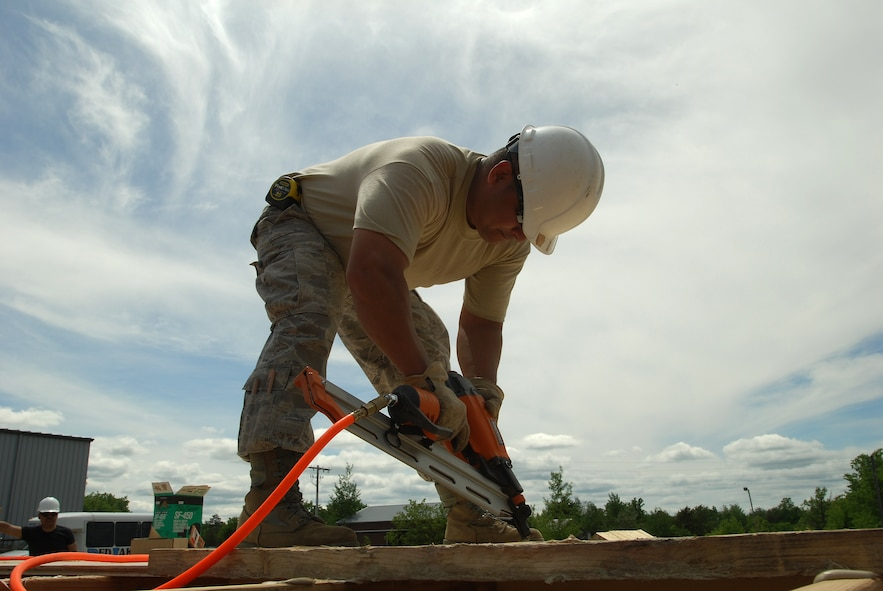 Members of the 433rd Civil Engineering Squadron conduct a humanitarian mission in the Red Lake Indian Reservation for the Red Lake band of Chippewa Indians, just outside of Bemidji, Minnesota. Tech. Sgt. Frank Mora, 433rd Civil Engineering Squadron, nails down a plywood subfloor before the rest of the house is built.(U.S. Air Force photo/Airman 1st Class Brian McGloin)