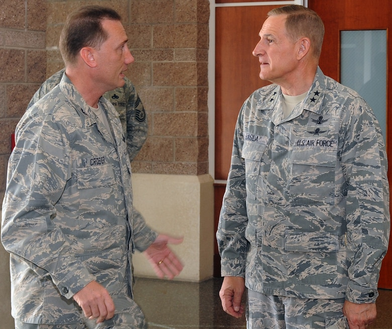 BUCKLEY AIR FORCE BASE, Colo. -- Maj. Gen. Michael Basla, Air Force Space Command vice commander, discusses space operations with Col. Clint Crosier, 460th Space Wing commander, during the general's visit to Buckley June 4.  (U.S. Air Force photo by Airman 1st Class Manisha Vasquez)