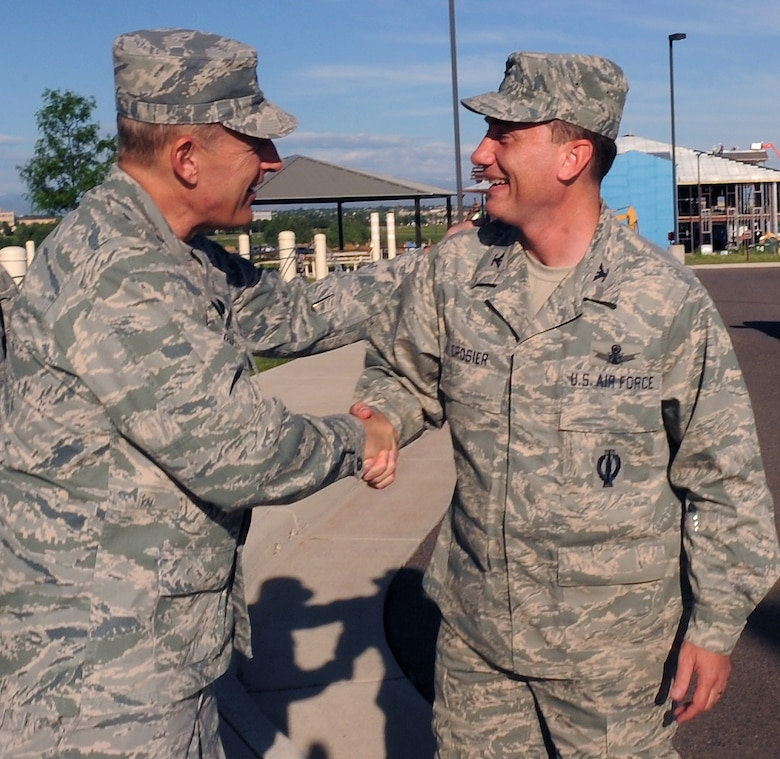 BUCKLEY AIR FORCE BASE, Colo. -- Maj. Gen. Michael Basla, Air Force Space Command vice commander, greets Col. Clint Crosier, 460th Space Wing commander, as he arrives at Buckley June 4. (U.S. Air Force photo by Airman 1st Class Manisha Vasquez)