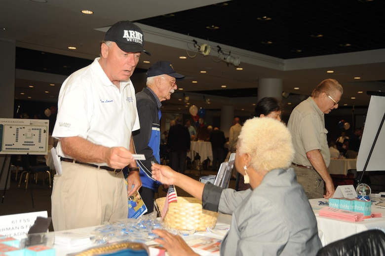 Army retiree Tom Lasser talks to a representative from the Airmen and Family Readiness Center at the annual Retiree Expo, June 26. (Photo by Joe Juarez)