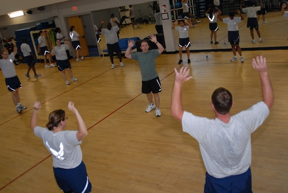 Brent Cowen, an exercise physiologist with Hurlburt Field's Health and Wellness Center, conducts the pyramid exercise during a Boot Camp class at the Aderholt Fitness Center, Hurlburt Field, Fla., June 24, 2010. The Hurlburt Field Boot Camp, run by the base's Health and Wellness Center, is a base-unique program that takes Airmen with marginal or failing scores through 80 days of intense physical training. (DoD photo by U.S. Air Force Staff Sgt. Orly N. Tyrell/Released)