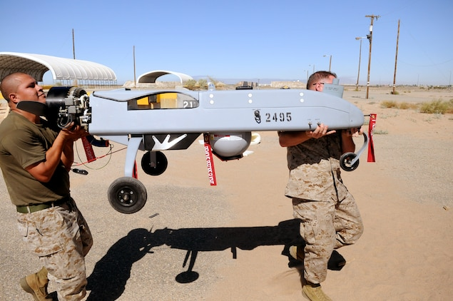 Sgt. Juan Fernandez, left, Marine Unmanned Aerial Vehicle Squadron 4 aircraft mechanic, and Lance Cpl. Victor White, squadron electrician, carry the main body of an RQ-7B Shadow during the squadron's initial inventory at the Marine Corps Air Station in Yuma, Ariz., June 29, 2010. A detachment of the squadron is currently setting up in Yuma and will be the active duty component of the reserve unit. The detachment received much of its equipment, including its four aircraft, on June 25 and is still receiving Marines, but will not be fully operational until the entire squadron is fully established. At its full strength, the detachment will comprise more than 40 Marines and sailors, as well as four unmanned aircraft.