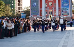 The U.S. Marine Corps Forces, Pacific Band marches into Sukhbaatar Square, Ulaanbaatar, Mongolia, kicking off a performance for more than 300 people June 30. The MarForPac Band participated in a subject matter expert exchange with the Mongolian Armed Forces from June 25 through July 5.