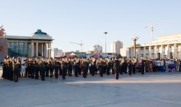 The Central Orchestra of the General Staff of the Mongolian Armed Forces (MAF Band), conducted by MAF Capt. E. Gansukh, performs traditional music during their part of a joint concert with the U.S. Marine Corps Forces, Pacific Band in Sukhbaatar Square, Ulaanbaatar, Mongolia, June 30. This is the fourth year the MarForPac Band traveled to Mongolia to participate in a subject matter expert exchange with their Mongolian counterparts.
