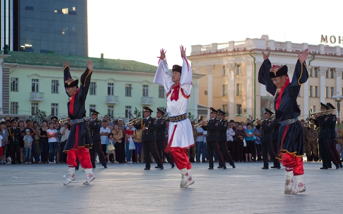 Traditional Mongolian dancers perform to the sounds of the Central Orchestra of the General Staff of the Mongolian Armed Forces (MAF Band) before a crowd of more than 300 people in Sukhbaatar Square, Ulaanbaatar, Mongolia, June 30. The MAF Band teamed up with the U.S. Marine Corps Forces, Pacific Band to hold the free, public concert.