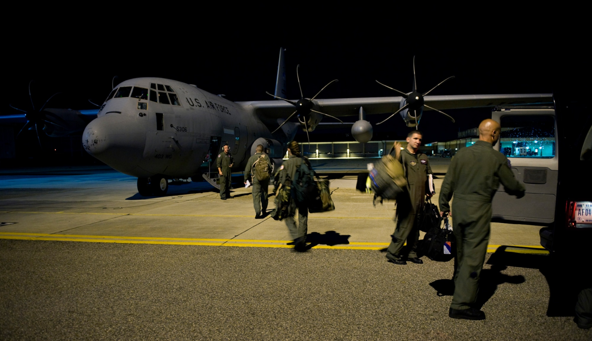 A Hurricane Hunter crew from the 53rd Weather Reconnaissance Squadron at Keesler Air Force Base, Miss, loads a WC-130J Hercules aircraft for a late night mission into Hurricane Alex June 29, 2010.  (U.S. Air Force photo/Master Sgt. Jack Braden)
