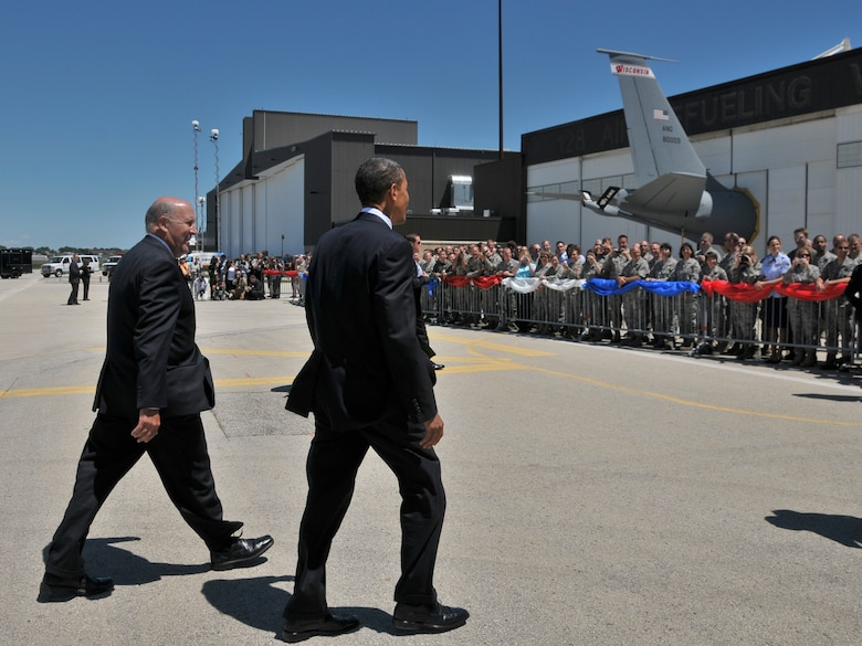 President Barack Obama and Wisconsin Gov. Jim Doyle head for members of the 128th Air Refueling Wing, Wisconsin Air National Guard waiting to meet the President June 30, 2010.  The President landed at the 128th in route  to a town hall meeting in Racine Wisconsin. (U.S. Air Force Photo by SMSgt Jeff Rohloff/released)