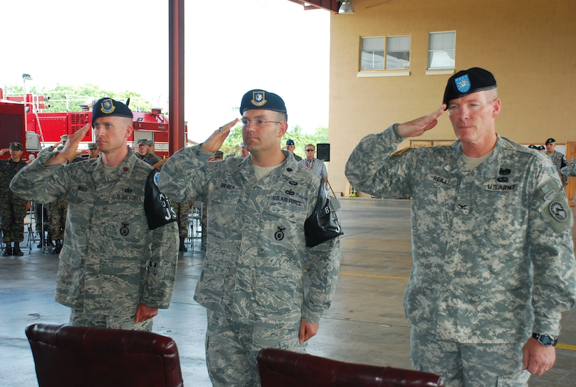 SOTO CANO AIR BASE, Republic of Honduras --  (From left) Maj. James Meier, Lt. Col. Theodore Breuker and Col. Gregory Reilly, the Joint Task Force Bravo commander, salute the colors during the playing of the Honduran and U.S. national anthems during a change of command ceremony here June 29. Major Meier took command of the Joint Security Forces here from Colonel Breuker. (U.S. Air Force photo/Martin Chahin)