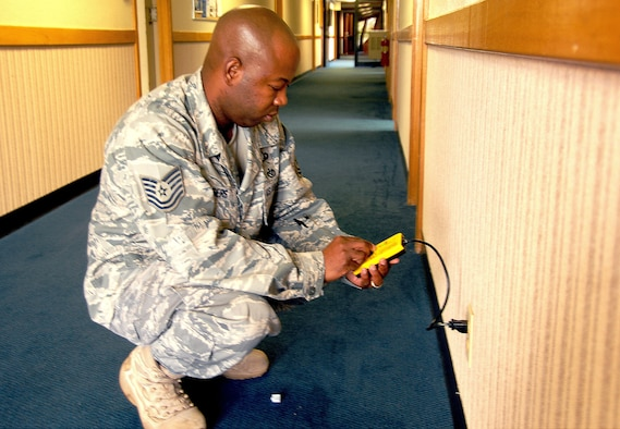 ANDERSEN AIR FORCE BASE, Guam - Staff Sgt. Carlos Rogers, 36th Wing ground safety manager, performs a safety check on an electrical outlet at the 36th Wing Headquarters building June 28.(U.S. Air Force photo by Airman Whitney Amstutz)