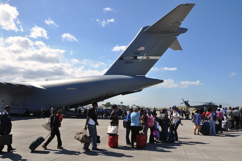 Evacuees board a C-17 Globemaster III from Travis Air Force Base in California. After dropping off Airmen, Soldiers, relief or logistical supplies, the Air Force used available space to take as many U.S. citizens back to the States as possible. More than 15,000 of U.S. citizens were repatriated during the operation. (U.S. Air Force photo/Capt. Dustin Doyle)