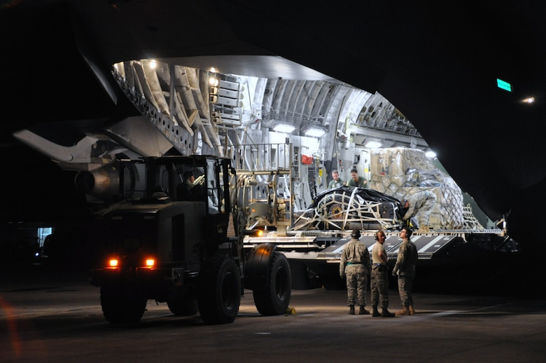 Upon arrival in Haiti, aerial porters from the 621st CRW immediately get to work unloading cargo and relief supplies from both military and civilian aircraft. The team downloaded more than 30 million pounds of relief supplies and equipment during the deployment. (U.S . Air Force photo/Capt. Dustin Doyle)