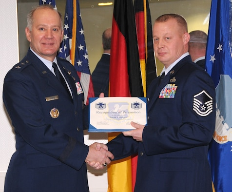 Master Sgt. David Dossett receives his promotion certificate from Maj. Gen. Ronald Ladnier, 17th Air Force commander, during his ceremony here Feb. 26. Sergeant Dossett is the 17th Air and Space Operations Center communication team section chief. (U.S. Air Force photo by Staff Sgt. Stefanie Torres)