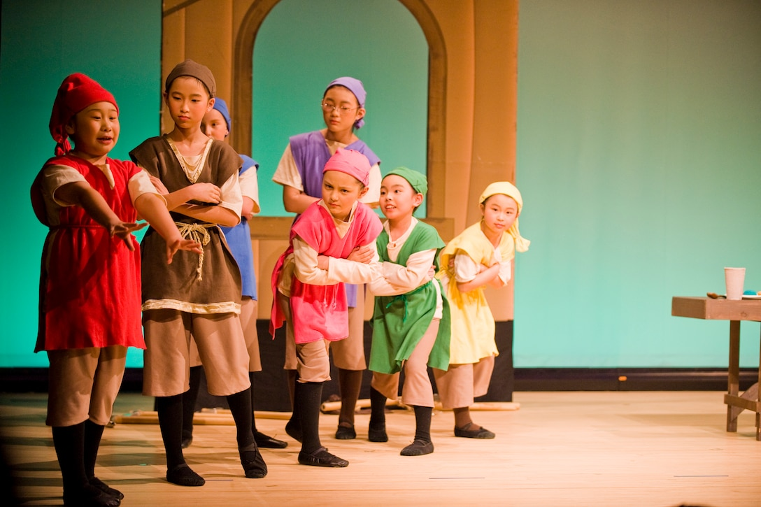 "MISAWA CITY, Japan -- Children playing the roles of seven dwarfs act out a scene during a musical rendition of ""Snow White"" Feb. 28 at the Misawa International Center. The musical was part of the Japanese and American Exchange Festival and was hosted by the Tohoku Defense Bureau. (U.S. Air Force photo/Senior Airman Jamal D. Sutter)"