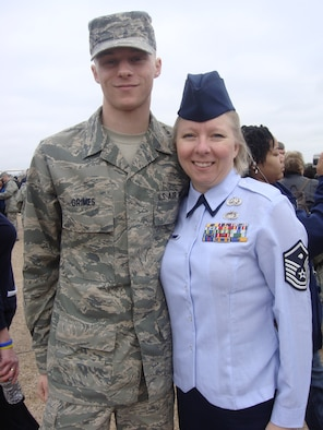 Master Sgt. Anja O'Neil, the new 129th Maintenance Group first sergeant, proudly celebrates her son, Airman 1st Class Jordan Grimes' graduation from Basic Military Training Feb. 5, 2010 at Lackland Air Force Base, Texas. (Photo courtesy of Master Sgt. Anja O'Neil)