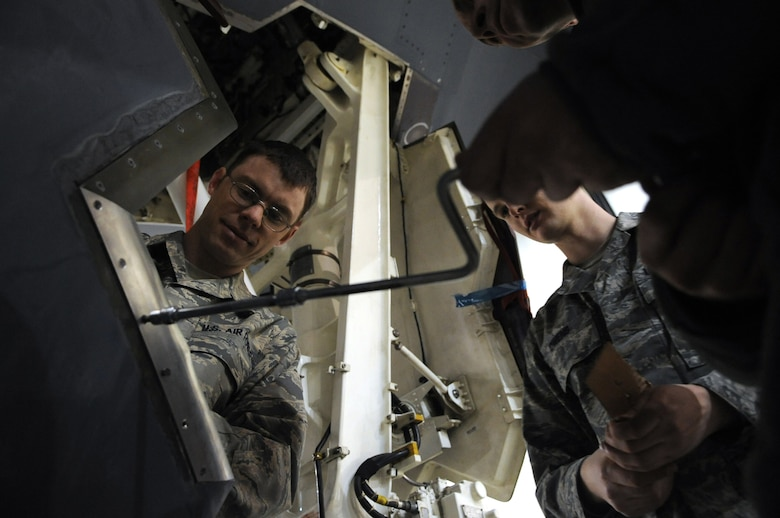 WHITEMAN AIR FORCE BASE, Mo. - Senior Airmen Tony Todaro (left) and Jason Owens, 509th Maintenance Squadron Aero Repair Shop technicians, replace a blade seal on the nose landing gear door of a B-2 Spirit Feb. 26, 2010. AR shop technicians perform a variety of unscheduled maintenance on B-2s daily. (U.S. Air Force photo/Senior Airman Jessica Snow)