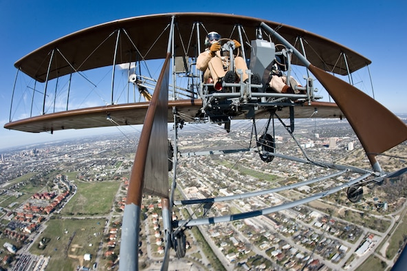 "Rich Stepler and Don Stroud, Wright ""B"" Flyer pilots, performed a demonstration flight of their ""Brown Bird"" March 2, 2010, over MacArthur Parade Ground at Fort Sam Houston, Texas, during the Foulois Centennial Military Flight Celebration event.  (U.S. Air Force photo/Lance Cheung)"