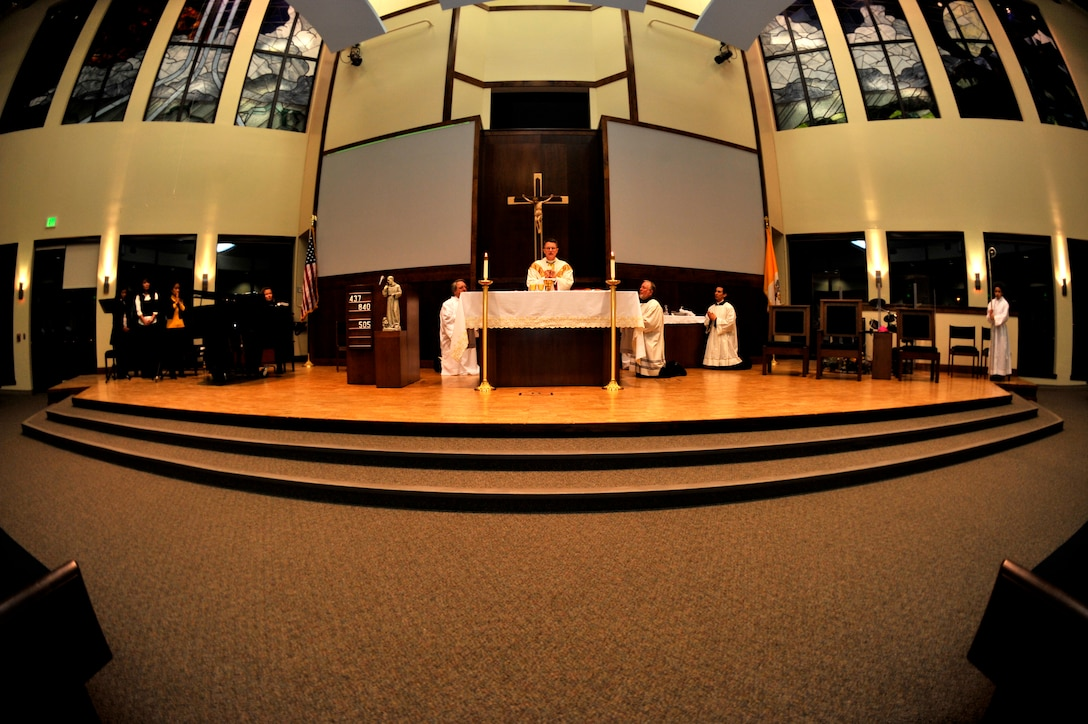 BUCKLEY AIR FORCE BASE, Colo. -- Archbishop Timothy Broglio officiates over the sacrament of confirmation Feb. 23 at the Buckley Chapel. Confirmation is one of seven sacraments celebrated by the Catholic faith. (U.S. Air Force photo by Airman 1st Class Paul Labbe)