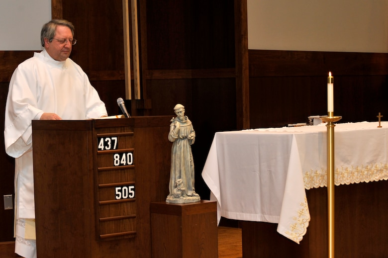BUCKLEY AIR FORCE BASE, Colo. -- Deacon Richard Borda, Buckley Chapel Roman Catholic coordinator, assists with the sacrament of confirmation service Feb. 23. (U.S. Air Force photo by Airman 1st Class Paul Labbe)