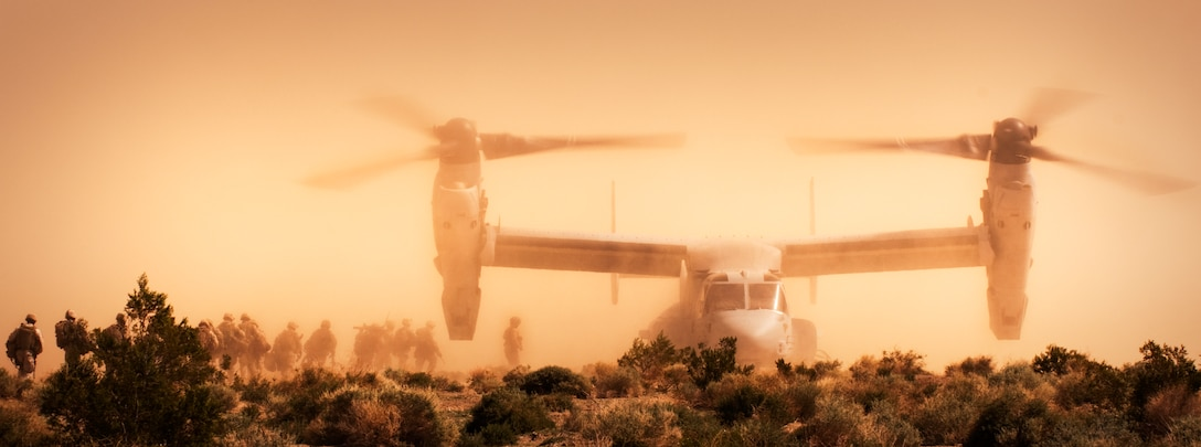 Marines and sailors from India Company, 3rd Battalion, 3rd Marine Regiment, make their way to a Marine Medium Tiltorotor Squadron 365 MV-22 Osprey near checkpoint 52 at Marine Corps Air Ground Combat Center Twentynine Palms, Calif. to fly out to Range 210 to conduct the Clear, Hold, Build Exercise 2H March 3. As the heloborne company, India was the only 3/3 company to fly into position for the exercise.