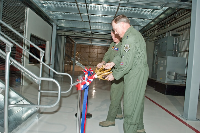 (Right) Maj. Gen. Stephen T. Sargeant, Air Force Operational Test and  Evaluation Center Commander, and  Maj. Gen. David J. Eichhorn, Air Force  Flight Test Center Commander, cut the ribbon and open the new mezzanine in  Building 1810 at Edwards AFB, Calif. , on Feb. 25. The building houses the  F-35 Joint Strike Fighter maintenance hangar and the mezzanine provides  approximately 6,000 square feet of workspace to the JSF Operational Test Team's  hanger for aircraft maintainers. Nearly 120 maintainers from the Air Force's  31st Test and Evaluation Squadron, Navy, Marine Corps, and United Kingdom will  use the work space. The project cost $690,000 and was funded by the Ministry  of Defence United Kingdom.