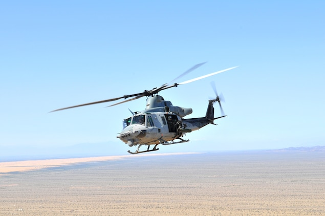 A UH-1Y Venom helicopter from Marine Light Attack Helicopter Training Squadron 303 flies over the Picacho State Recreation Area, Calif., March 3, 2010. The squadron was conducting familiarization flights to train new aviators in the operations of their aircraft and formation flying, before loading their weapons and attacking the Barry M. Goldwater Range's Yodaville urban target complex for weapons training.