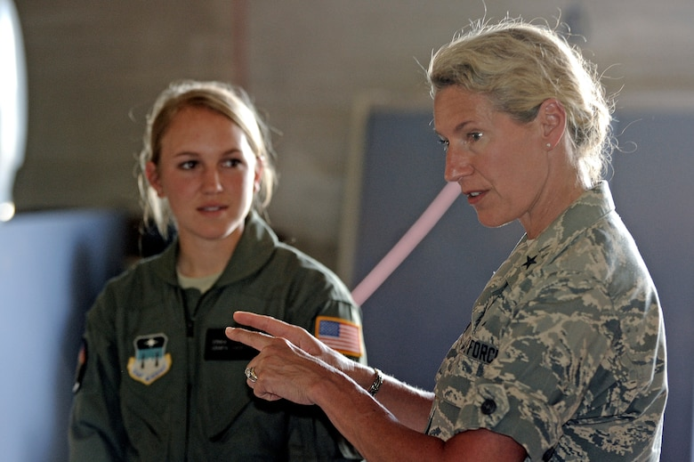 Brig. Gen. Dana Born speaks to a group of cadets, including Cadet 3rd Class Erika Martin from Cadet Squadron 08, during a visit to the Academy's Unmanned Aerial System-Remotely Piloted Aircraft training program at Fort Carson July 23, 2009. General Born is a 1983 graduate of the Academy and the first female dean of the faculty. (U.S. Air Force photo/Mike Kaplan)