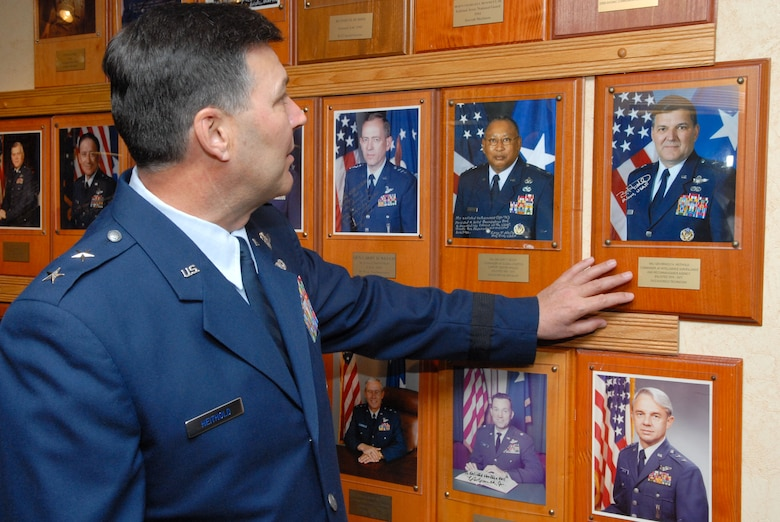 Maj. Gen. Bradley Heithold uncovers his photo at the Enlisted Heritage Hall wall of achievers on Gunter Feb 26.(U.S. Air Force photo/Bennett Rock)