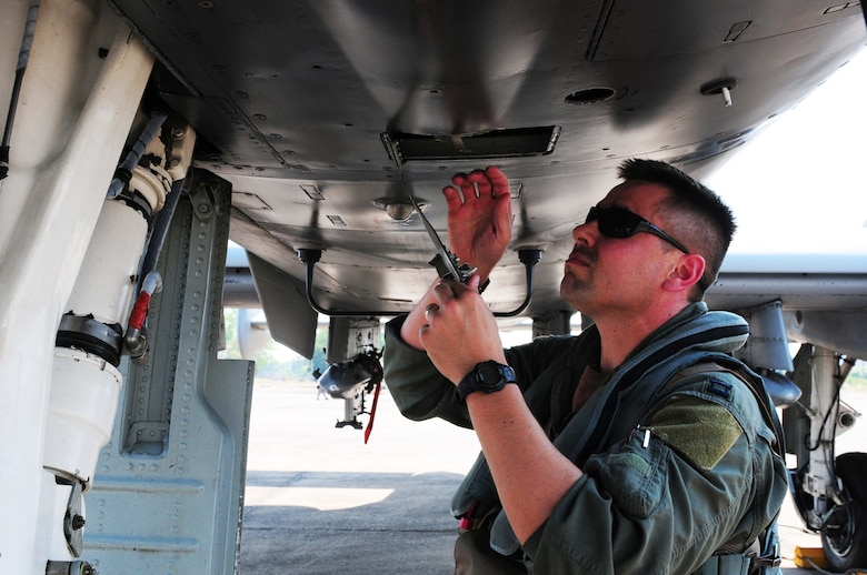 Capt. Matthew Lackey conducts an exterior inspection of an A-10 Thunderbolt II prior to flying the first A-10 mission of Cope Tiger 2010 at Udon Thani Royal Thai Air Force Base, Thailand, on March 4. Captain Lackey is deployed to the exercise from the 25th Fighter Squadron at Osan Air Base, South Korea.  His squadron is participating in the annual, multilateral field training exercise involving the U.S. Air Force, Royal Thai Air Force and Army, and the Republic of Singapore Air Force March 1-12.  (U.S. Air Force photo/Capt. Genieve David)