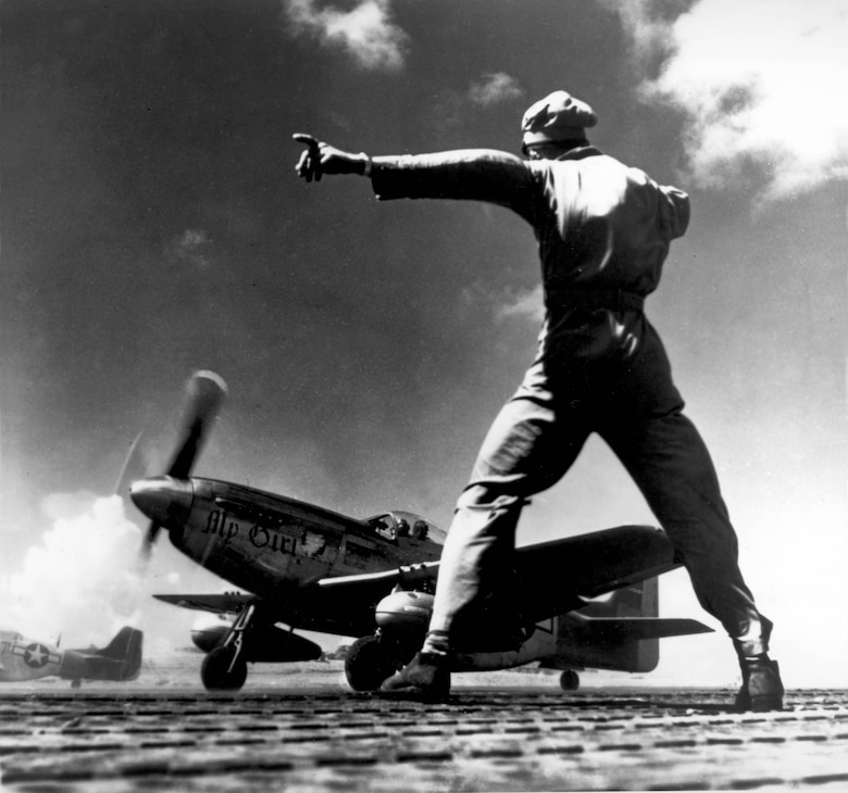 "ANDERSEN AIR FORCE BASE, Guam -""MY GIRL"" a P-51 takes off from Iwo Jima. From this hard-won base U.S. Air Force fighters escorted the B-29's on bombing missions to Japan, and also attacked the Empire on their own. Image was used in the book, ""Third Report of the C.G. of the A.A.F. to the Secretary of War"". 1945 (U.S. Air Force photo)"